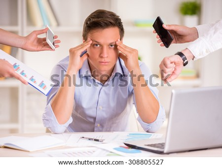Tired businessman in his office. He needs a rest. - stock photo