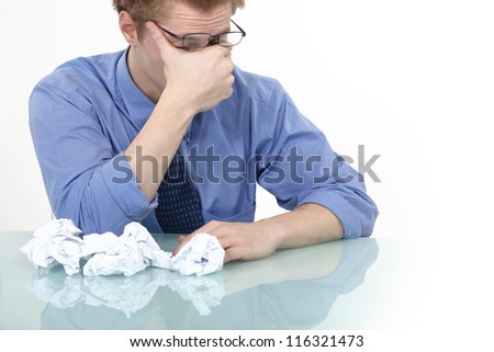 tired businessman rubbing his eyes - stock photo