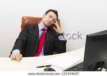 Tired businessman sleeping in his office chair at work. - stock photo