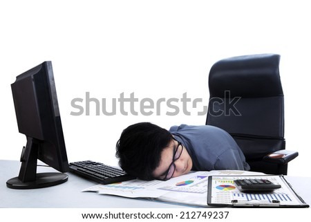 Tired businessman sleeping on the desk. isolated on white background - stock photo