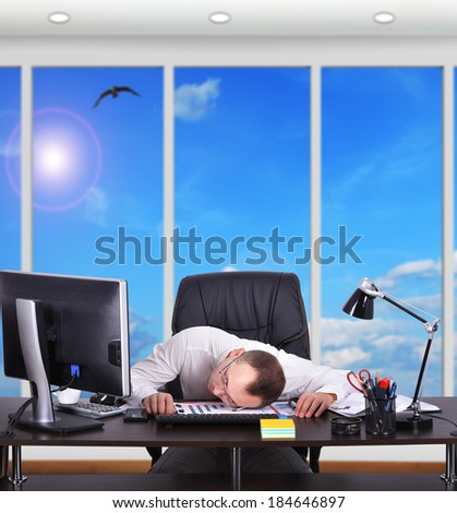 Tired businessman sleeping on the table - stock photo