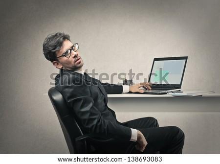 tired businessman working hard - stock photo