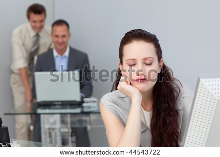 Tired businesswoman sleeping at her desk in the office - stock photo