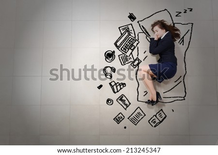 Tired businesswoman sleeping on floor and dreaming - stock photo
