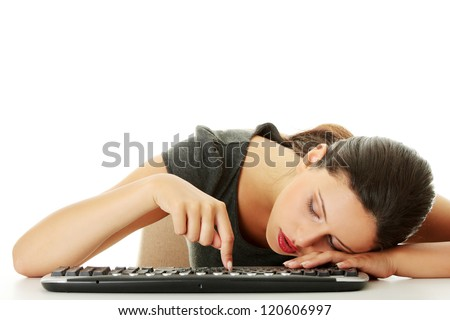 Tired businesswoman typing on keyboard, isolated on white - stock photo