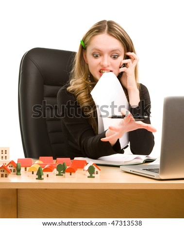 Tired businesswoman with telephone and a sheet of paper in her mouth sitting - stock photo
