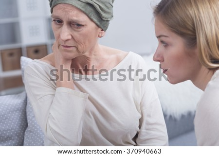 Tired cancer woman and her sad daughter sitting  - stock photo