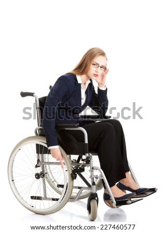 Tired caucasian businesswoman on a wheelchair - stock photo