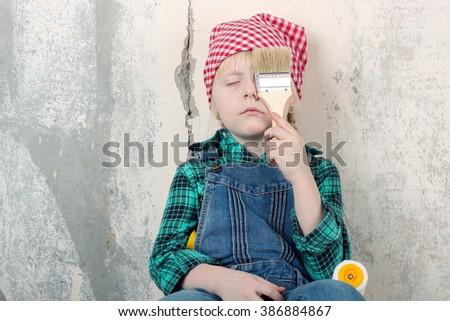 tired child girl making new apartment repair - stock photo