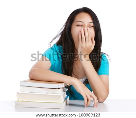 tired college student with stack of books - stock photo