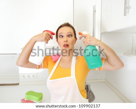 tired crazy housewife in kitchen - stock photo