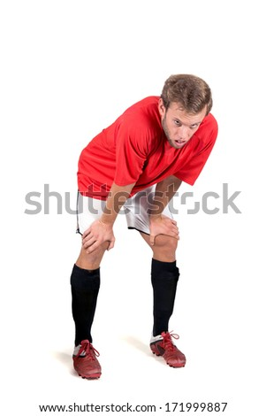 Tired football player isolated in white - stock photo