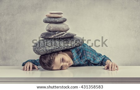 Tired girl under pressure - stock photo