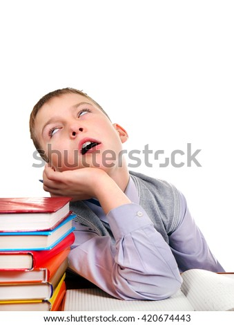 Tired Kid on the School Desk Isolated on the White Background - stock photo