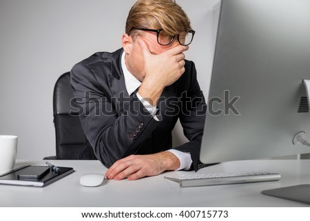 Tired man  holding his forehead  - stock photo