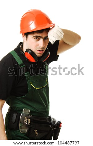 Tired man in a construction helmet on a white background. - stock photo