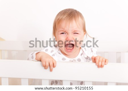 tired screaming crying little baby - stock photo