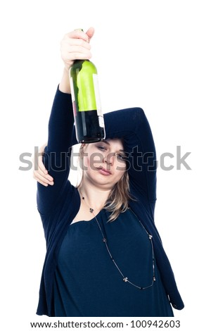 Tired sleepy drunk woman holding bottle of wine, isolated on white background. - stock photo