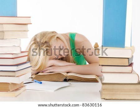 tired student fell asleep at the table. - stock photo
