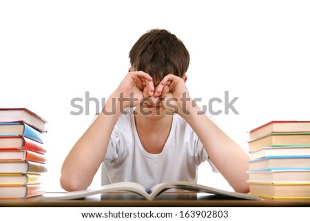 Tired Student Rub his Eyes Isolated on the White Background - stock photo