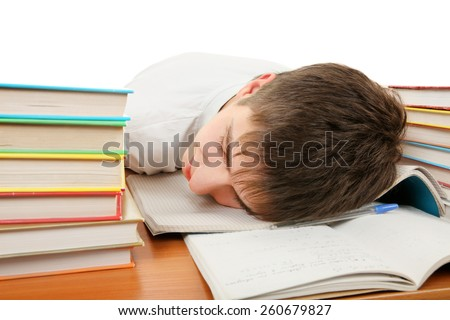 Tired Student sleep on the School Desk on the White Background - stock photo