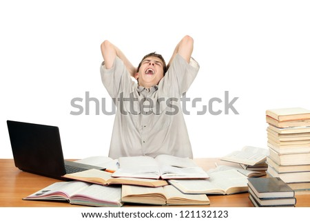 Tired Student Yawning on the School Desk. Isolated on the White - stock photo
