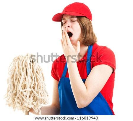 Tired teenage girl in her work uniform, holding a mop and yawning.  Isolated on white. - stock photo