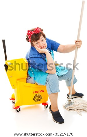 Tired unhappy cleaning lady sitting in her mop bucket.  Isolated on white. - stock photo