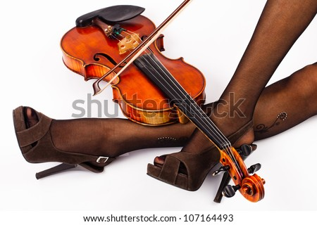 Tired violinist with her instrument - stock photo