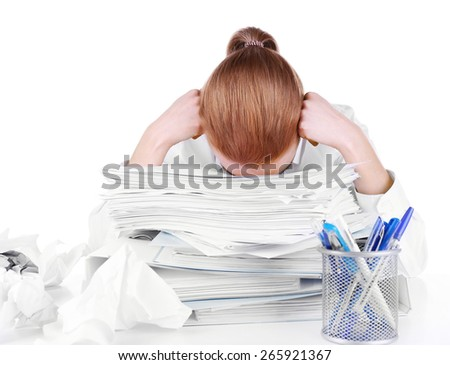 Tired woman at her workplace with documents isolated on white - stock photo