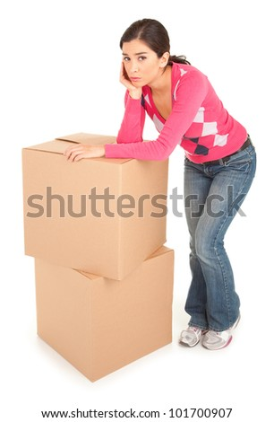 Tired Woman Leaning on a Cardboard Box - stock photo