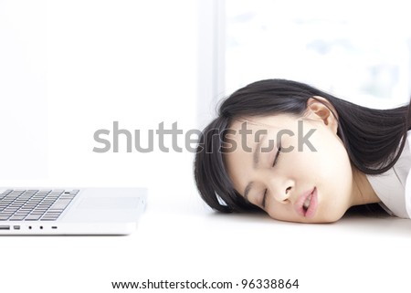 tired woman sleeping at laptop - stock photo