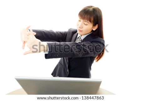 Tired young Asian woman - stock photo