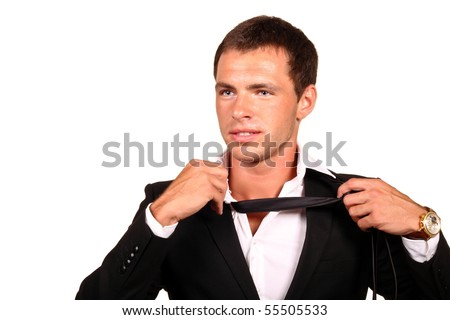 Tired young businessman taking off his tie. Isolated on white. - stock photo