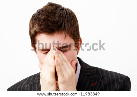 tired young handsome man - stock photo