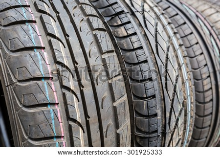 Tires stack background. Selective focus. - stock photo