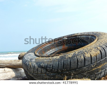 Tires washed ashore from the sea - stock photo