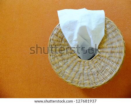 Tissue box on orange background - stock photo
