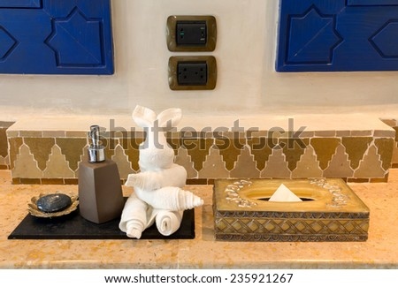 Tissue box, Towel, Hand Gel and Soap in Luxury Bathroom - stock photo