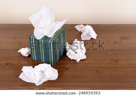 Tissue box, used tissues.  Copy space. - stock photo