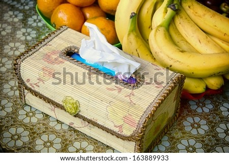 Tissue box with fruits. - stock photo