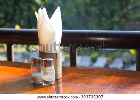 Tissue component. Bottle, salt and pepper on the table. - stock photo