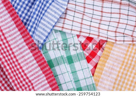 Tissue, kitchen towels, tablecloths. Background, texture. Cloth background. Multi-colored kitchen towels. In the kitchen. Tablecloths. Plaid fabric. - stock photo