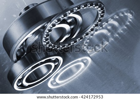 titanium ball-bearings and pinions used for the aerospace industry - stock photo