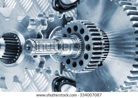 titanium cogwheels and gears used in aerospace and rocket industry - stock photo