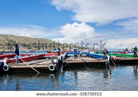 TITICACA LAKE, BOLIVIA - APR 05, 2015: Ferry service on lake Titicaca between the towns of San Pedro de Tiquina and San Pablo de Tiquina. - stock photo
