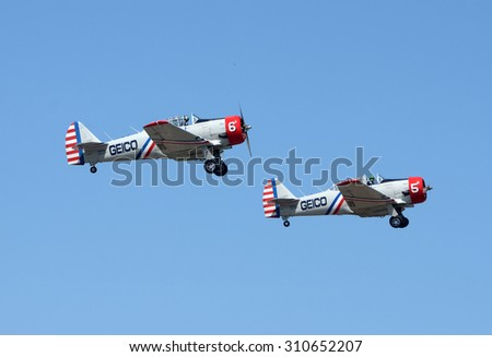 TITUSVILLE - MARCH 15, 2015: Members of the Geico Skytypers aerobatic team depart from Titusville, Florida on March 15, 2015 on the way to an airshow - stock photo