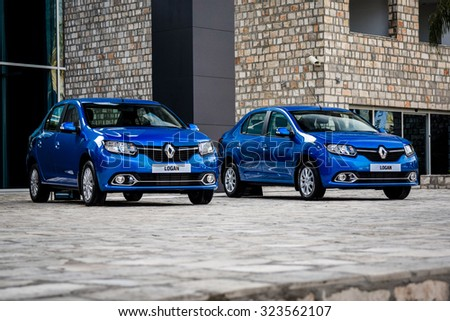 TIVAT, MONTENEGRO - APRIL 28, 2014: New Renault Logan II (Russian-spec) at the first test-drive event. Renault Logan II was launched in 2014 and is manufactured in Togliatti, Russia at AvtoVAZ plant. - stock photo