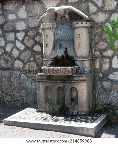 TIVOLI/ITALY - AUGUST 26, 2014 : Drinking water fountain for people and animals - stock photo