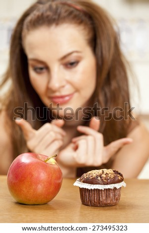 To choose an apple or a muffin - stock photo